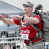 Seth Budimlija carries a 40-lb. ruck sack the full length of the half marathon at the Joplin Memorial Marathon on Saturday at Memorial Hall. <br /> Globe | Laurie Sisk