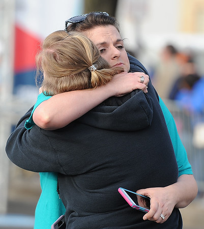 Former Freeman employee Edie Howard hugs a friend after finishing the 5K during the Joplin Memorial Run on Saturday at Memorial Hall. Howard lost her husband and two small children, who perished at Home Depot during the May 2011 tornado.<br /> Globe | Laurie Sisk