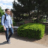 Jacob Harp walks through the courtyard by Missouri Southern's Billingsley Student Center on Tuesday. Jacob and his mother, Tammy Harp, are both set to graduate this May.<br /> Globe | Laurie Sisk