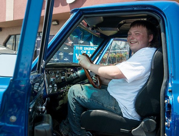 Globe/Roger Nomer<br /> Richard Gray smiles from the cab of his newly restored truck on Friday at Price Cutter in Joplin.