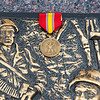 Globe/Roger Nomer<br /> A medal is places on a memorial to Vietnam veterans at Mount Hope Cemetery on Monday.