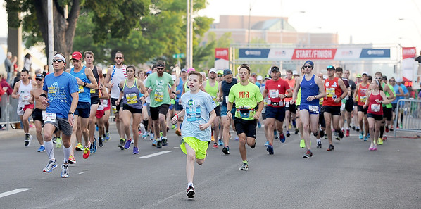 Full and half marathon runners take to the course at the start of the Joplin Memorial Run on Saturday at Memorial Hall. <br /> Globe | Laurie Sisk