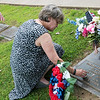 Globe/Roger Nomer<br /> Monica Dixon, Joplin, cleans the headstone of her son Edward Dixon on Monday at Mount Hope Cemetery. Edward Dixon died while serving with the army in Afghanistan in 2011.