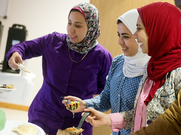 Globe/Roger Nomer<br /> (from left) Sisters Salma Moustafa, Amna Moustafa and Nashwa Ghoniem, Crowder students from Egypt, serve Egyptian food during Monday's International Food Festival at Crowder College.