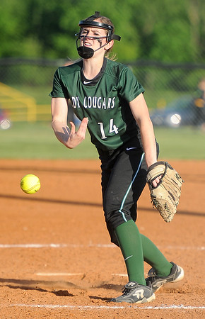 College Heights pitcher Nevada Moenning delivers a pitch during the Cougars'  Class1, District 11 semifinal game against Diamond on Tuesday at Diamond.<br /> Globe | Laurie SIsk
