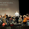 "Col. L. Bryan Shelburne Jr., former director of the U.S. Army Band, conducts the orchestra in preparation for a return performance of ""The Other Side of Storm,"" during rehearsal on Wednesday at Joplin High School.<br /> Globe 