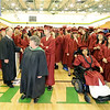 Eager Joplin High School graduates wait inside Robert Ellis Young Gymnasium before the start of ceremonies on Sunday at Leggett & Platt.<br /> Globe | Laurie Sisk