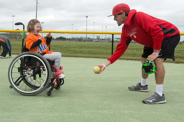 Globe/Roger Nomer<br /> Evan Hutcheson, Carl Junction, plays catch with Charlotte Arrowsmith, 5, at the Will Norton Miracle Field. Buddies and athletes of all ages come to field to enjoy the game.
