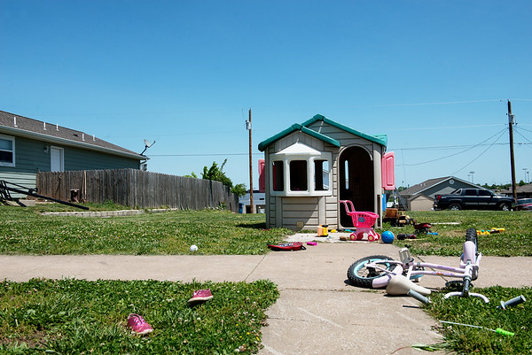 Globe/Roger Nomer<br /> A child's playhouse occupies an empty lot near 23rd and Kentucky. Although many neighborhoods have built back in the tornado zone, several empty lots remain.