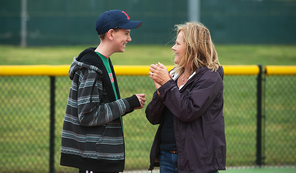 Globe/Roger Nomer<br /> Trish Norton talks with her buddy Macabe Sprenkle, 12, Oronogo, as the pair play in the field during a game at the Will Norton Miracle Field on Saturday, April 30.