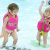 From the left: three-year-old Lucille Wolf and one-year-old Brookelyn Wolf enjoy the cool waters of Cunningham Pool on Saturday during opening day of Joplin Pools.<br /> Globe | Laurie Sisk