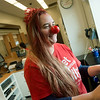 Globe/Roger Nomer<br /> Erin Rawlins, a pharmacy tech at the Rangeline Walgreens, dresses up for Red Nose Day on Thursday. Walgreens is one of several sponsors for the charitable day that supports many domestic and international programs to fight childhood poverty.