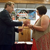 Globe/Roger Nomer<br /> Tim Whelan, executive vice president of TAMKO Building Products, awards Becky Graves with the American Red Cross Heroes award on Friday at the Butcher's Block Event Center.