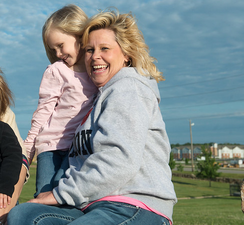 Globe/Roger Nomer<br /> Lily Graddy, 4, gives Teresa Worley a hug at Cunningham Park on Saturday evening.