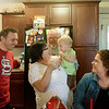 Globe/Roger Nomer<br /> Tamara Comer plays with her granddaughter Remington Palmer, 1, at a gathering with friends and family including (from left) Samantha Palmer, Jeremiah Comer, Darren Wilkinson, Bobbi Comer and Ryan Macy on Thursday, April 21, at her house on Kentucky Avenue. After the 2011 tornado destroyed her house, Tamara Comer rebuilt in the same location because she wanted to be near her family.