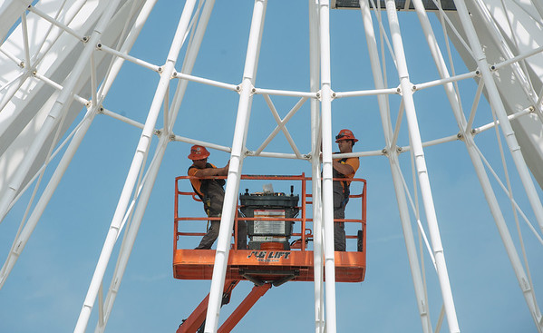 Globe/Roger Nmer<br /> Cosmin Dubestan, left, and Dorel Petreli, with Dutch Wheels Installation, work on the Branson Ferris Wheel on Tuesday.