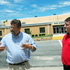 Globe/Roger Nomer<br /> Jeff Davis, Superintendent of Greenfield, left, and Jason Fulp, manager of marketing and public relations at Missouri Sun Solar, talk about solar panels on top of Greenfield High School on Wednesday.