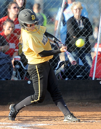 Diamond's Whitney DeGonia connects for an rbi during the Wildcats Class1, District 11 semifinal game against College Heights on Tuesday at Diamond.<br /> Globe | Laurie SIsk