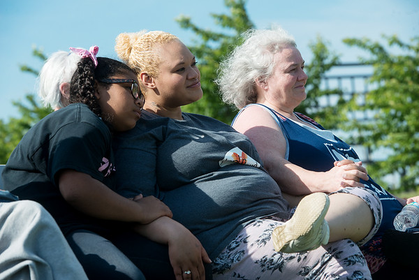 Globe/Roger Nomer<br /> (from left) Jayla Barnes, 8, Brandi Nolen and Sheri Nolan listen to music on Sunday at Cunningham Park.