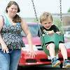 Two-year-old C.J. Melton and his aunt, Tanna Holler, take advantage of a break in the rain on Wednesday at Cunningham Park.<br /> Globe | Laurie Sisk