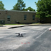 Globe/Roger Nomer<br /> Jason Fulp, manager of marketing and public relations for Missouri Sun Solar, prepares to take drone footage of solar panels at Greenfield Elementary on Wednesday.