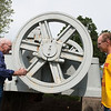 Globe/Roger Nomer<br /> Randall, left, and Norman Hayes, Galena, look at a rock crusher at the Joplin Museum Complex on Monday.