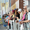 Hundreds of spectators watch as runners make their way to the finish line during the Joplin Memorial Marathon on Saturday at Memorial Hall. <br /> Globe | Laurie Sisk