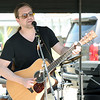Jason Kinney, of the Jason Kinney Band, entertains the crowd on the outdoor stage at the Dr. John H. Galey Art and Music Festival on Saturday in Neosho. The event featured two stages of live music, artists exhibits anda kids' art contest. <br /> Globe | Laurie Sisk