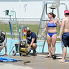Joplin Parks and Recreation workers and Ewert Pool lifeguards ready Ewert Pool on Wednesday in preparation for the pool's opening on Saturday.<br /> Globe | Laurie Sisk