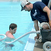 Ewert Pool lifeguard Collin Shipley, left and Jereme Glenn, of Joplin Parks and Recreation, vacuum Ewert Pool on Wednesday in preparation for the pool's opening on Saturday.<br /> Globe | Laurie Sisk