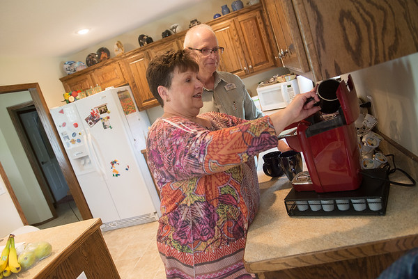 Globe/Roger Nomer <br /> Naomi and John Hunter make coffee at their home in Webb City on Wednesday.