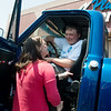 Globe/Roger Nomer<br /> Richard Gray's sister Brandie Ward looks at the cab of his newly restored truck on Friday at Price Cutter in Joplin.