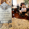 An inspitational plaque is displayed in the waiting area of the Cut Loose Salon. The business was the first in Joplin to acquire a building permit from the city to rebuild.<br /> Globe | Laurie Sisk
