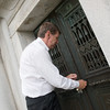 Globe/Roger Nomer<br /> Tom Hamsher, general manager, unlocks the Schifferdecker mausoleum on Friday at Mount Hope Cemetery.