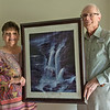 "Globe/Roger Nomer<br /> Naomi and John Hunter display the Jack Dawson painting ""Peace in the Midst of the Storm"" which survived the 2011 tornado in their previous house."