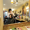 Stylist Carrie Volrath works with client Melissa Huff at Cut Loose Salon.<br /> Globe   Laurie Sisk