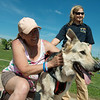 Globe/Roger Nomer<br /> Susan Bragole pets Zeus, held by Jenny Moser of 4-State Search and Rescue on Sunday at Cunningham Park. Bragole lost her home in the 2011 tornado.