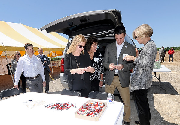Part of the Kansas Crossing management team greet visitors to a groundbreaking ceremony for the casino and hotel complex on Thursday near Pittsburg.<br /> Globe | Laurie Sisk