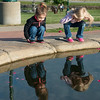 Globe/Roger Nomer<br /> Sisters Lola, 2, and Lily, 4, Graddy look for fish at Cunningham Park on Saturday evening.