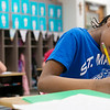 Globe/Roger Nomer<br /> St. Mary's Elementary second grader Daniela Ndukwu works on assignment on Thursday, April 14.