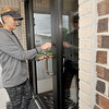 Cut Loose Salon owner Dianna Collins locks the front door of her salon on a Monday - the one day she works alone in the bustling salon.<br /> Globe | Laurie Sisk