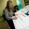 Globe/Roger Nomer<br /> Adrienne Jackson, secretary of the Joplin Regional Community Foundation, fills out a ceremonial check to Lafayette House on Tuesday.