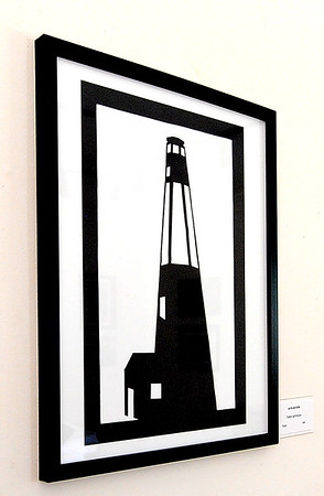 Katie Watson's cut paper piece of a lighthouse hangs in ArtCentral's Hyde House on Tuesday.<br /> Globe | Laurie Sisk