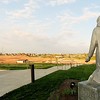 A statue os St. John looks over construction of the new Mercy Park.<br /> Globe | Laurie Sisk