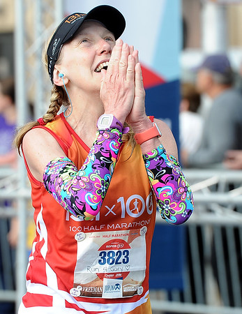 Ann Hegstrom raises her eyes to the heaven's after finishing the half marathon during the Joplin Memorial Marathon on Saturday at Memorial Hall. <br /> Globe | Laurie Sisk