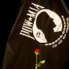 Globe/Roger Nomer<br /> A single rose on the POW/MIA Table honors soldiers during the Memorial Day ceremony at the Bicknell Center for the Arts on Monday.