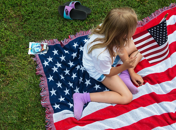 Globe/Roger Nomer<br /> Lydia Hipple, 7, Joplin, waves a flag during the Memorial Day ceremony on Monday at Mount Hope Cemetery.