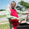 Globe/Roger Nomer<br /> Jonathan Sprinkles, board member for SOS Ministries, cooks chicken during a cook out for area businesses at the Washington Education Center on Tuesday.
