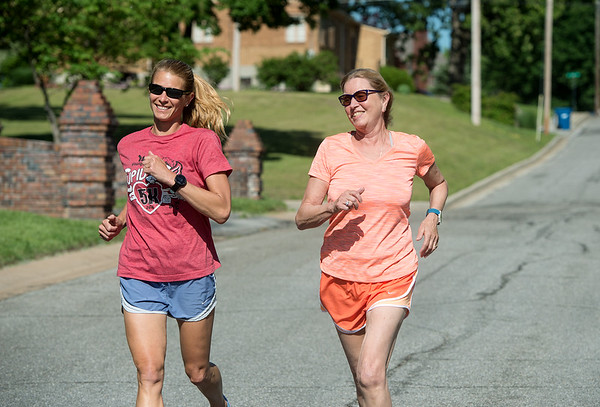 Globe/Roger Nomer<br /> Shannon Satterlee, left, and her stepmother Linda Pine, Atlanta, Ga., run on Tuesday afternoon.