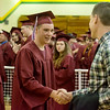 Globe/Roger Nomer<br /> Isaac Boyd gets congratulations from Brendon Cooney, english teacher at Joplin High, before Sunday's ceremony at the Leggett and Platt Athletic Center.